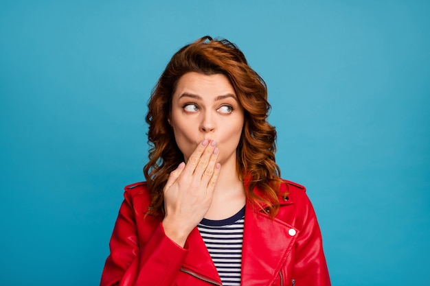 Close-up portrait of her she nice-looking attractive mysterious funny wavy-haired girl closing mouth looking aside rumor gossip isolated over bright vivid shine vibrant blue color background