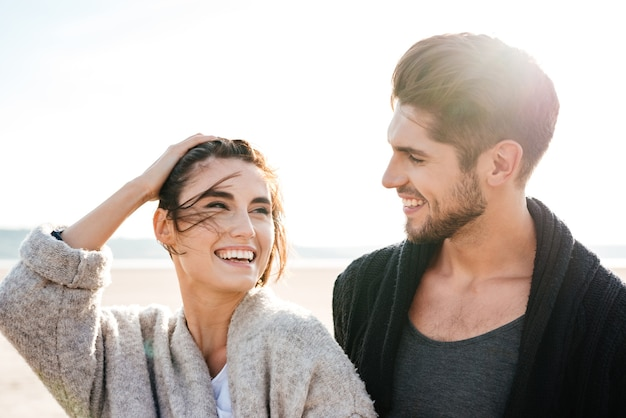 Close up portrait of a laughing young couple on the seashore