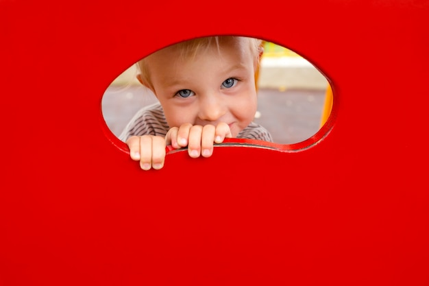 Close up portrait of a little girl playing on the playground. copy space.