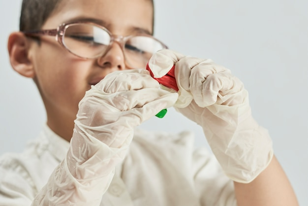 Close up portrait of a little scientist experimenting with slime