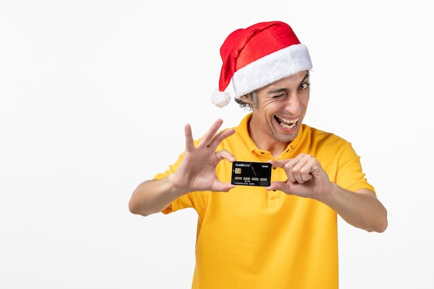 Close up portrait of male courier wearing santa hat isolated