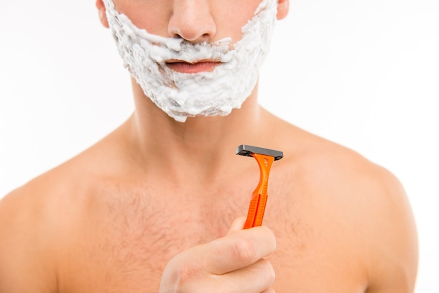 Close up portrait of male holding a  razor