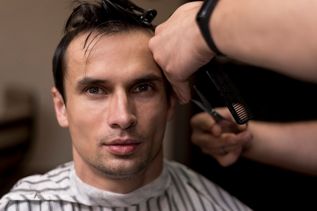 Close up portrait of a man getting a haircut