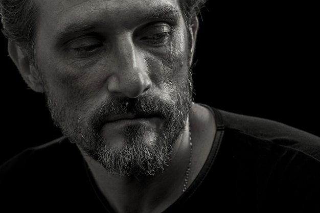 Close up portrait of mid aged man concerned about life difficulties.