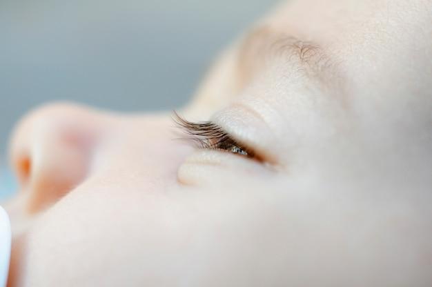 Close-up portrait of newborn baby girl.