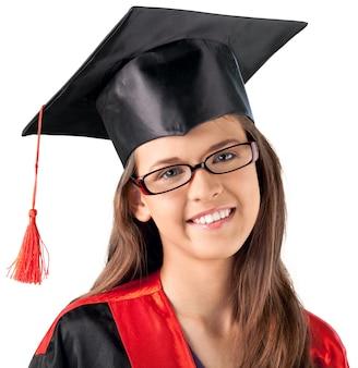 白い背景の上の眼鏡と卒業帽子の美しい少女の肖像画をクローズアップ