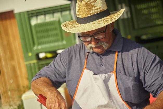 Close up portrait of old master craftsman