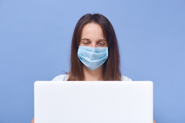 Close up portrait of online teacher with protective mask tutoring over internet