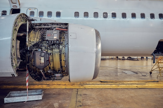 Close up portrait of open engine in the repair and routine maintenance on aircraft in the aerodrome