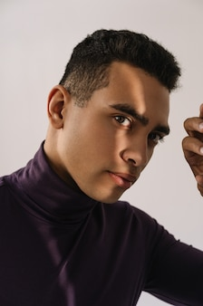 Close up portrait of pensive african american fashion model posing for pictures in studio, isolated background