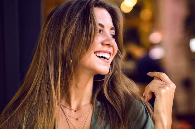 Close up portrait of portrait magnificent young sensual model with long brown hairs and shy cute smile, natural pure beauty, soft make up .