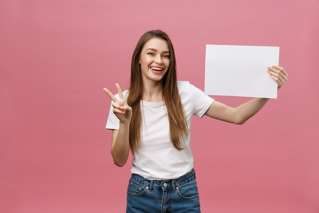 Close up portrait of positive laughing woman smiling and holding white big mockup