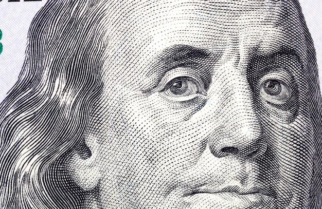 Close-up of a portrait of the president of one hundred american dollars, real paper notes of freely convertible american currency
