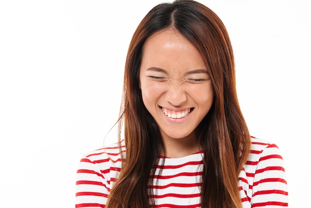 Close up portrait of a pretty young asian girl laughing