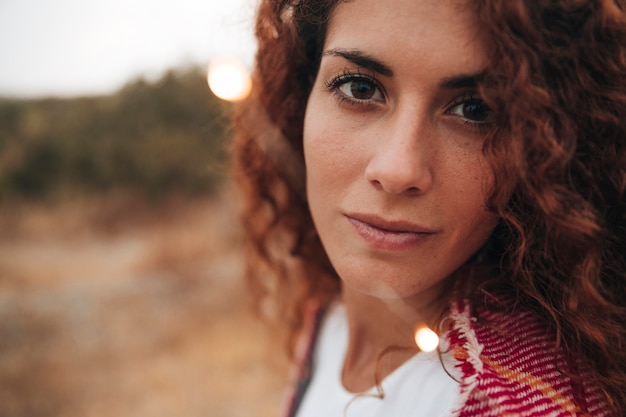 Close-up portrait of a redhead woman