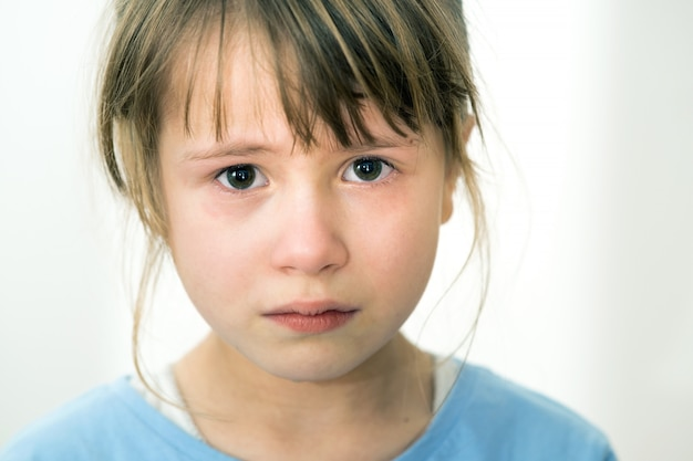 Close up portrait of sad crying child girl