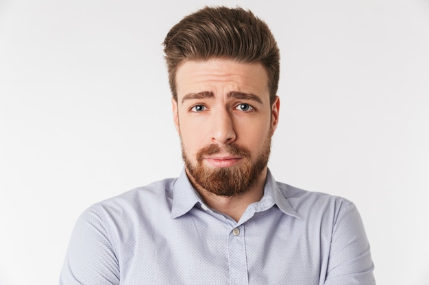 Close up portrait of a sad young man dressed in shirt