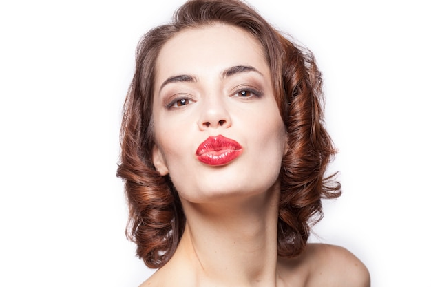 Close up portrait of a sexy caucasian woman giving kiss