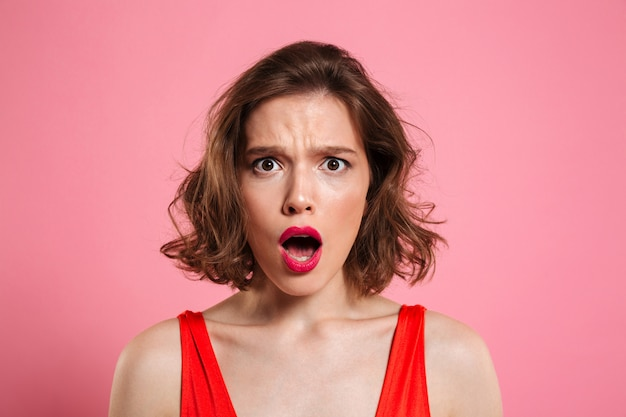 Close up portrait of a shocked pretty woman