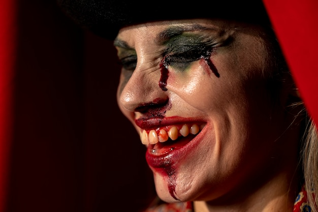 Close-up portrait of sideways clown woman with her eyes closed