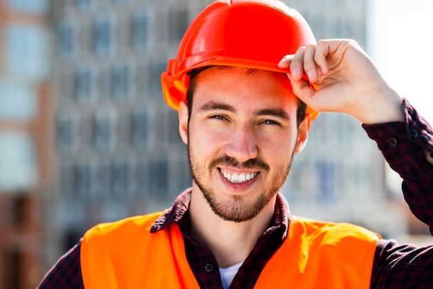 Close-up portrait of smiling construction engineer