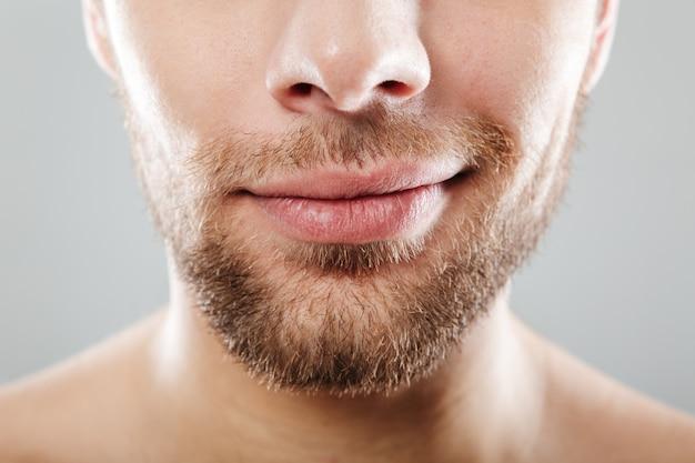 Close up portrait of smiling half men's face