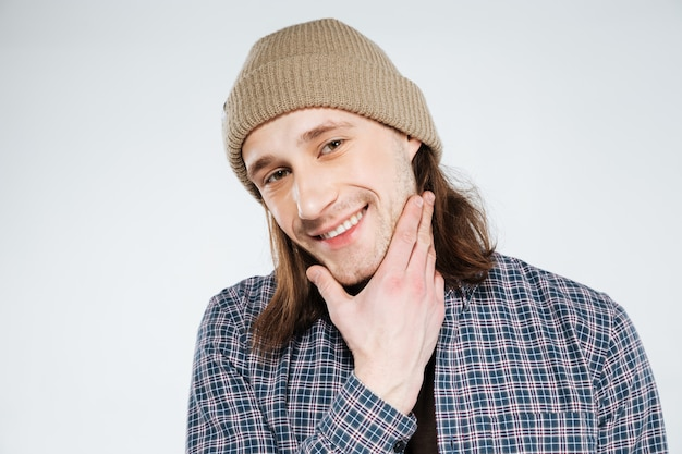 Close up portrait of smiling hipster holding chin