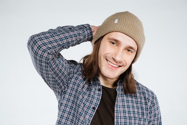 Close up portrait of smiling hipster holding head