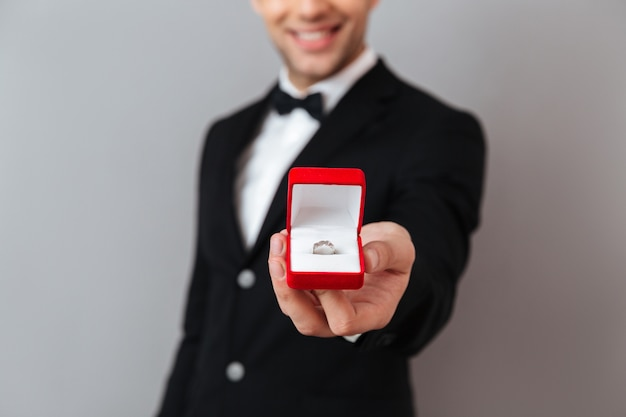 Close up portrait of a smiling man dressed in tuxedo