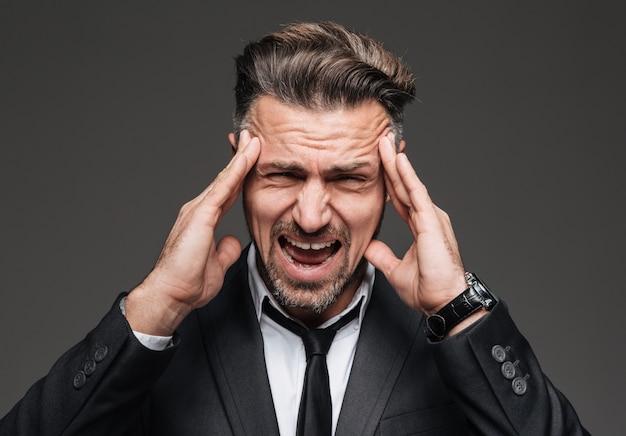 Close up portrait of a stressed mature businessman