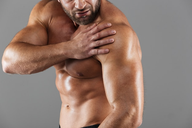 Close up portrait of a strong muscular male bodybuilder