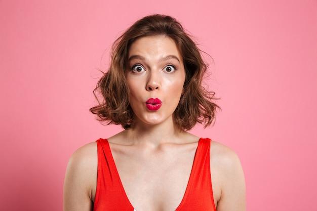 Close up portrait of a surprised pretty woman