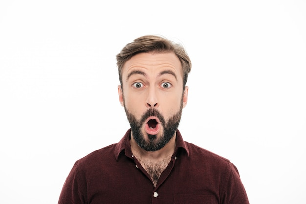 Close up portrait of a surprised young bearded man