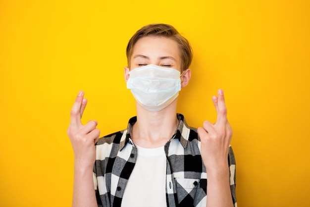Close-up portrait of teen boy healthy wearing safety gauze mask