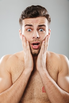 Close up portrait of a terrified half naked man