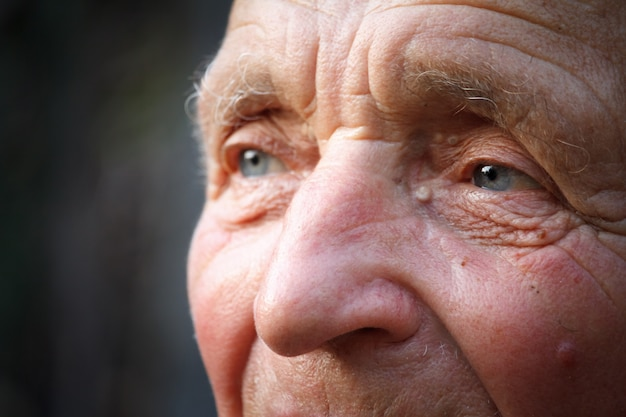 Close-up portrait of a very old man