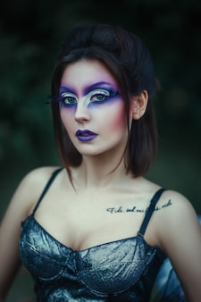 Close-up portrait of  woman with creative makeup