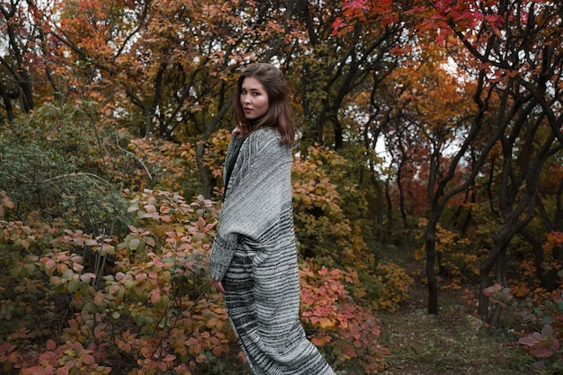 Close up portrait of a young asian woman outdoor. autumn warm concept.