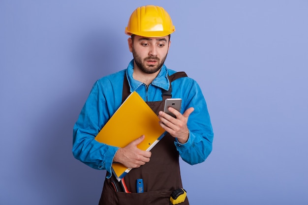Close up portrait of young attractive engineer dresses blue shirt