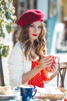 Close-up portrait of young beautiful woman wearing red beret.
