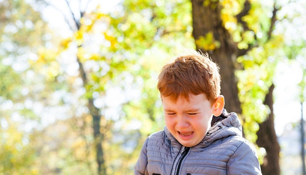 Close up portrait of young boy crying