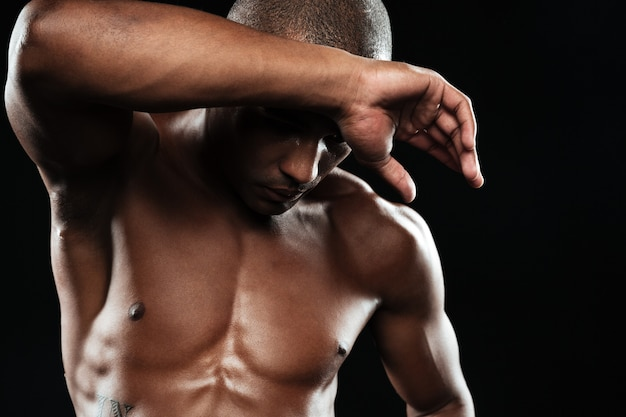 Close-up portrait of young muscular afro american sports man, chilling after workout