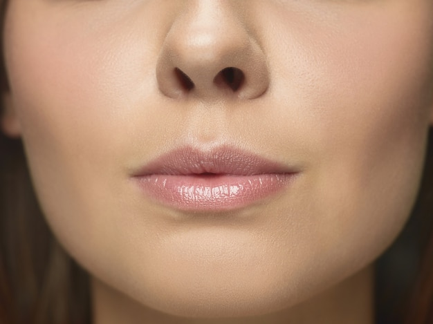 Close-up portrait of young woman's face. female model with well-kept skin and big lips. concept of women's health and beauty, cosmetology, cosmetics, self-care, body and skin care. anti-aging.