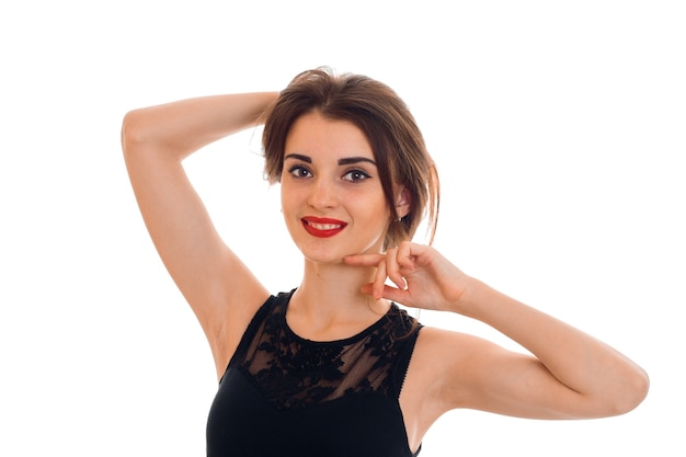 Close up portrait of young woman with red lips posing and looking at front isolated on white wall in studio