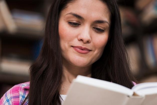 Close-up positive woman reading a novel