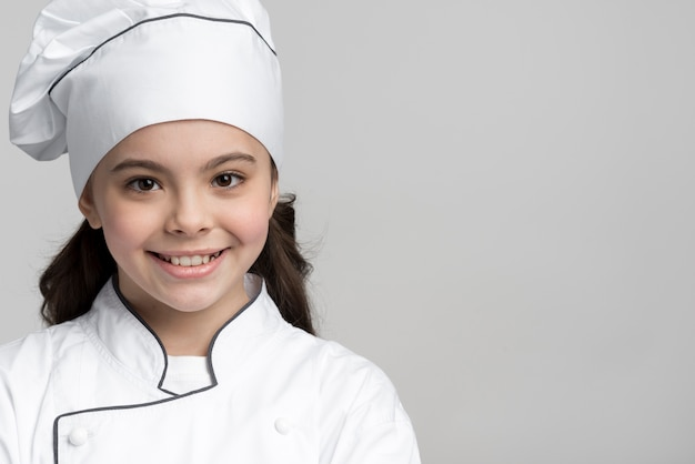 Close-up positive young chef smiling