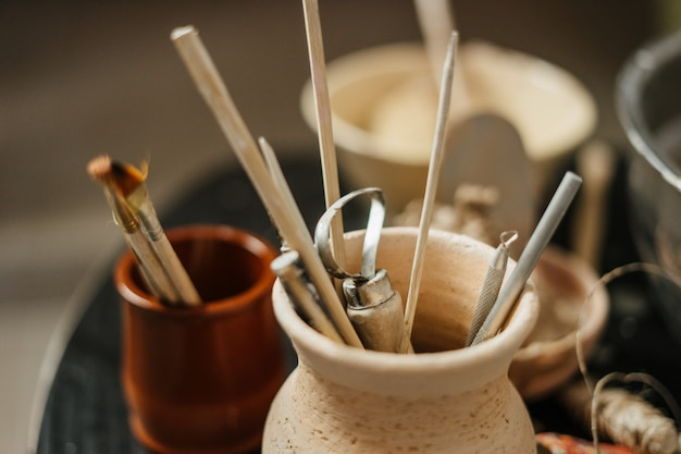 Close-up of pottery tools at ceramic workshop