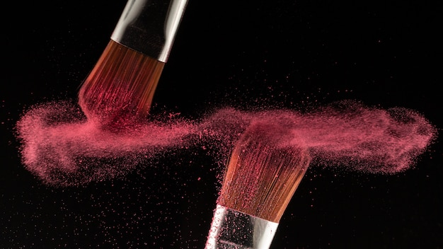 Close up powder splash and brush for makeup artist or beauty blogger