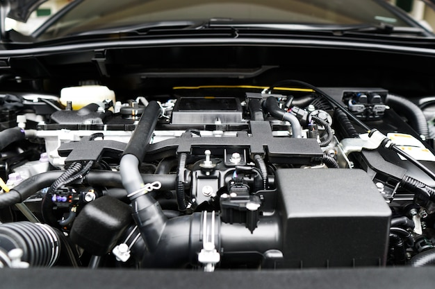 Close up of the powerful car engine. internal design of engine. automobile metal new car engine part details.