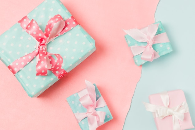 Close-up of presents in different sizes placed on dual background
